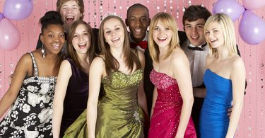 Teens dressed up and posing at prom party