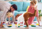 Family playing twister together at home