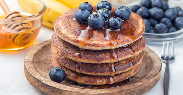 Banana oat pancakes with honey and blueberry