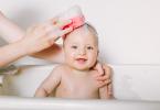 Baby smiling getting a sponge bath